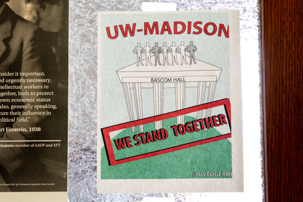 A poster with an illustration of Bascom hall that says UW–Madison We Stand Together