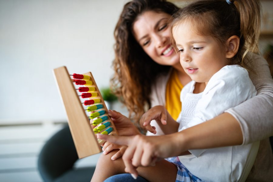 Mother and little girl, kid playing with abacus, early education